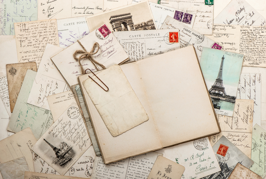 open empty diary book, old letters, french postcards. scrapbook